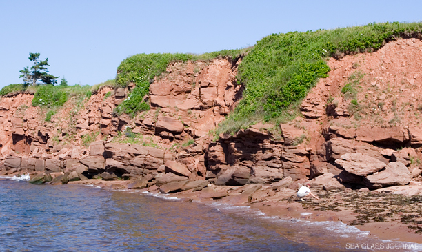 Sea glass collecting along the red sandstone cliffs found all along Prince Edward Island.